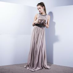 Dress Jenny Packham, clutch Valentino, yearings Lanvin