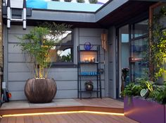#Unique #planters in a #London #roof #terrace with #lighting and #colour