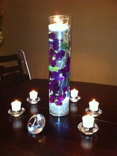 I think this one has floating candle & LED. i love it!   flowers submerged in water in hurricane vase with floating candle on top