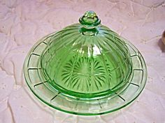 Green Depression Glass Butter, Covered  These are always a great find.  Especiallly if they have the original lid.  They can be an added decorative item on a formal dinner table.  The color is so clear that they are bound to get someones attention.