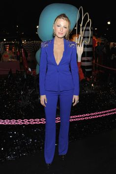In an Elie Saab suit at the opening of Gaga's Workshop at Barney's New York in 2011. See all of Blake Lively's best looks.