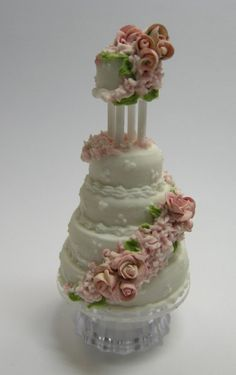 …another lovely mini wedding cake from Cynthia Howe's 'A Piece of Cake'.  Cake made by Maple Leaf Miniatures.