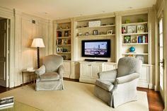 Custom faux finished built in bookcase in a library sitting room remodeled and built by J. Allen Smith Design Build