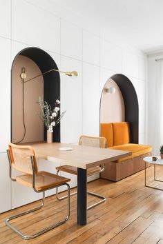 Arched wall niches + mustard seat cushions + bar height table + can counter stool + adjustable arm wall sconce + modern design + commercial interior design + restaurant design + booth seating + casual dining spaces Cafe Interior Design, Cafe Design, Interior Architecture, House Design, Commercial Furniture, Commercial Interiors, Architecture Parisienne, Wall Shelves Design, Interior Inspiration
