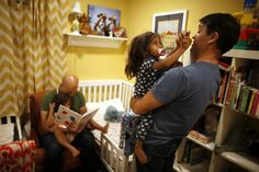 Jason Howe, 50, (2nd L) and his husband Adrian Perez-Boluda, 50, put their twin three-year-old daughters Olivia (L) and Clara to bed at their home in Los Angeles, California, United States, June 25, 2015. Howe and Perez-Boluda married in Spain and in California in 2008. REUTERS/Lucy Nicholson