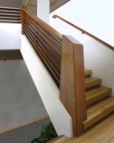 contemporary wood stair railing - beautiful chunky wood with a mid century and/or art deco modern feel