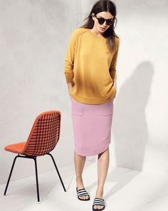 Andreea Diaconu for J.Crew - women's merino swing sweater, adilette slippers, and crepe shirttail skirt.
