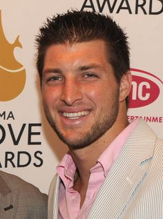 Even when he is not sweating and kicking butt at playing football and being an inspirational Christian.... Tim Tebow always manages to be completely handsome.