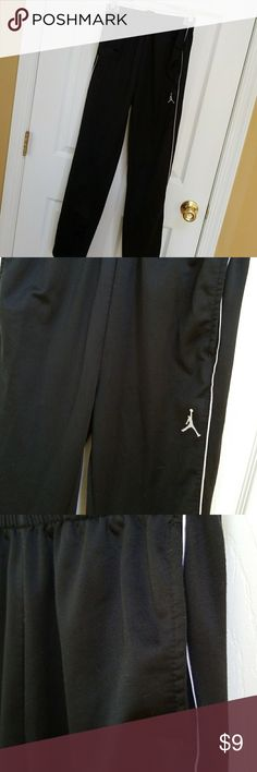 Boys air Jordan workout pants Boys size large black with white stripe workout pants. Elastic waistband with inside bring to tie. Are in good condition. hidden pocket to each side. waste will adjust plastic from about 22 to 26 or 27 inches. Length approximately 37.5 inches. Air Jordan Bottoms Sweatpants & Joggers
