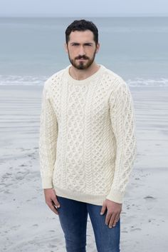 LATTICE ARAN SWEATER This aran wool sweater is extremely comfortable and feels lighter in weight than our traditional hand knit sweaters, making it perfect to wear as a layering piece or with a jacket. It features the lattice or basket stitch which was said to depict the pattern of the old Fisherman's basket and was used as an omen for a good catch. This is a popular stitch that is still being used in many of today's new as well as traditional designs.