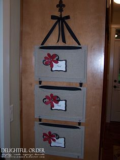 SO am gonna make this!! Mail Organizer to hang on the wall by the door using fabric files and ribbon!