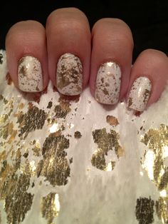 thesparklequeenjolene: Gold splatter nails! Got my inspiration from my new fauxfur white and gold scarf that I'm obsessed with currently. ...