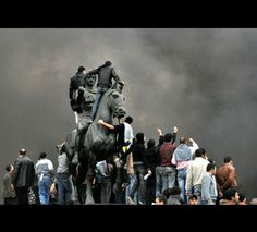 Egyptian demonstrators ather on the statue of Alexander the Great in Alexandria on Friday.