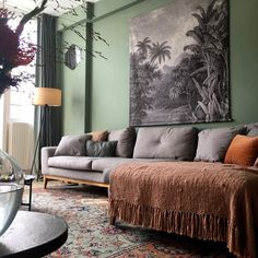 Gray tapestry over a gray sofa green walls a beautiful green clay patterned rug LivingRoom Living Room Paint, Living Room Decor, Bedroom Decor, Interior Design Living Room Warm, Living Room Designs, Paint Colors For Home, Stores, Green Clay, Rugs
