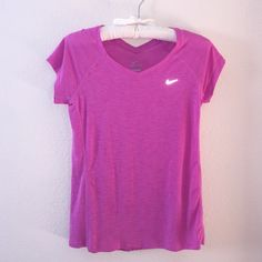 Nike Workout Top Nike sign reflects! Magenta burn out tee from Nike. Small pull as noted in picture, not to noticeable. Good used condition. Additional picture or information requests are always welcomed! ☺️ Nike Tops Tees - Short Sleeve