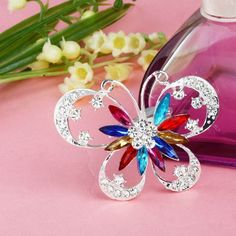 Buyinhouse New Fashion Ladies Girls Silver Plated Flashing Multi-colour Rhinestones Crystals Cute Hollow Butterfly Brooches Pin Clips Buyinhouse http://www.amazon.com/dp/B00JQU58QG/ref=cm_sw_r_pi_dp_7RX8ub0Y7T05K