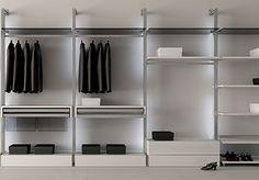 Vestidores modernos Domine, el sistema de almacenamiento mas exclusivo, fabricados en materiales de alta calidad como acero y vidrio que aportan elegancia.