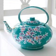 <3 a watering can in the form of a tea pot.