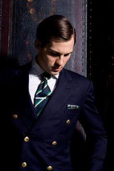 Navy double-breasted blazer, white shirt, navy tie with green & white stripes