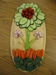 Flower veggie plate. Book lists 16 reasons to eat raw.