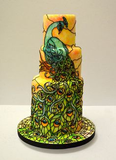 Peacock ~ stained glass effect on cake with royal icing piping and edible painting ~ an edible piece of art