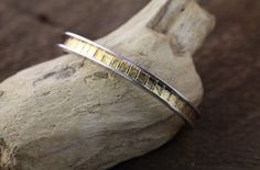 Silver, 22k Gold leaf bracelet made by Birgit.
