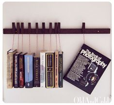 Custom made wooden book rack. movable pins.