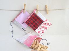 Useful unique red drawstring pouch.  Drawstrings patchwork  pouch is perfect for your most delicate things. It also will keep all your favourites in one place when traveling.   You can hang it on a bathroom door or a bed post.     Hand made cotton sachet is:  > inch 7,87 x 5,9 - cm. 20 x 15  > hand made with printed cotton fabric   > finished with ribbons at the edge  > lined with white cotton fabric  > Care By: Machine Wash in Cold on Delicate. Do not dry in dryer - lay flat to dry. Iron as…