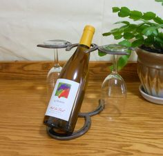 Horseshoe wine bottle and glass holder by Bar 18 Creations. Bar 18 Creations original design.