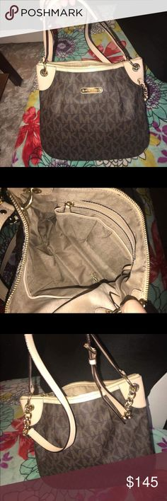Michael Kors Convertible Cross Body Michael Kors Convertible Cross Body                                      Very Good Used Condition                                                 Can Be Worn as Cross Body or Shoulder Bag                   Very Clean Interior No Tears, Stains, Rips, or Odors          Brown Monogram Michael Kors Bags Crossbody Bags