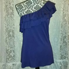 One shoulder ruffletop Purple one shoulder ruffle top. Perfect for summer. Spring too with Jean jacket over top. Worn once. Excellent shape. Needs new home! Smoke free home. Offers welcome Old Navy Tops Blouses
