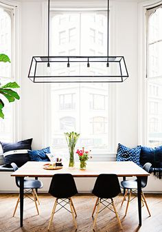 Dining room décor ideas | Blue décor accents | Black framed pendant | Window seating | Photo by Brittany Ambridge via Domino #wishtankworthy ♥