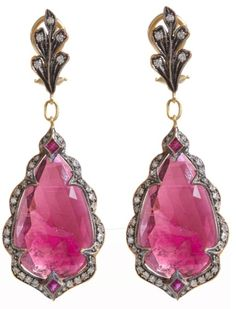 "Drop earrings. They're pretty, all right. Or I should say, IT'S pretty. Did you ever notice how often on Pinterest, instead of showing an actual pair of earrings, ""they"" just copy and paste the same image twice. Look at the patterns of light in the pink s http://amzn.to/2srmb87"