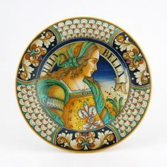 An astonishing wall plate by one of the most famous Renaissance portrait artists in Deruta, Alvaro Binaglia, whose best pieces are owned by the local Museum of Ceramics. Our collection of Italian artistic ceramics features many masterpieces by Alvaro, each of them painstakingly hand painted and hand glazed to achieve its precious antique patina.