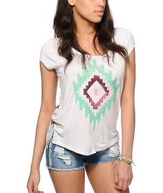 Standout with your style in this lightweight and soft-feel rayon top that features a relaxed fit with a tribal print graphic at the front, and tribal print back panel.