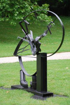 """Re-Run, a 67"""" h x 65"""" w x 37"""" d scrap metal sculpture created by Carole Eisner in 2001"""