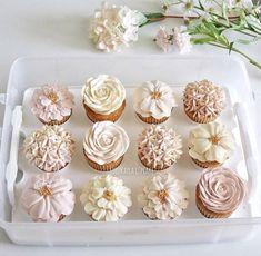 These are some gorgeous floral cupcakes! They would be a hit at your floral baby shower, love the neutral shades!