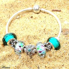 Pandora Beach Theme Bangle with Teal Faceted and Sea Glass Faceted Murano's. Silver Sea Star Charm and Spacers. #MyPandora