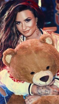 Demi Lovato with a BIg stuffed Teddy Bear