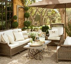 Saybrook All-Weather Wicker Wingback Armchair | Pottery Barn -- PILLOWS