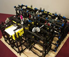 Elaborate drawing machine made out of Legos that scribbles at the turn of a crank.