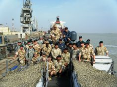 UMM QASR, Iraq (Nov. 14, 2009) Members of Mobile Diving and Salvage Unit (MDSU) 2, the Royal Navy and members of the Iraqi Defense Forces pose for a photo aboard the coastal patrol boat USS Firebolt (PC 10).