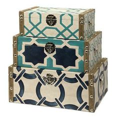 These fun printed, decorative boxes in shades of navy, blue, and teal would make a great accent in any beach house.