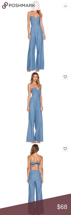 NWT Lovers + Friends blue jumpsuit In a cute chambray fanfic. Perfect for summer. Open to offers using the offer button. From revolve Lovers + Friends Pants Jumpsuits & Rompers