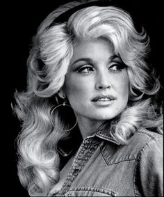 Yes...Dolly. I am not a country music fan but I do like some of her songs. I think she is the only person who can really pull off a somewhat 'cheap look' style with beauty and grace.
