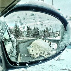 Winter wonderland in the side mirror Photo by Mercedes Blair -- National Geographic Your Shot