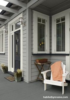 The grainy, organic depth of Resene Caraway is perfect for the weatherboards in this cool, contemporary scheme and it's repeated again on the painted deck fo...