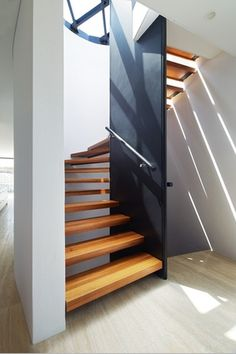 Blane Brackenridge Architecture_ Terrace Houses, Fremantle --> Sunlight filters through the open risers of the central horseshoe- shaped staircase in each home.