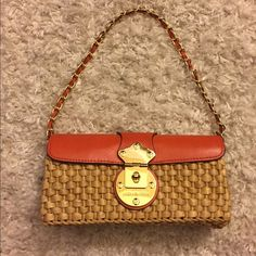 Michael Kors purse. Michael Kors basket weave baguette with orange leather and gold chain strap.   Front hardware has minor scratches otherwise perfect condition. Michael Kors Bags Mini Bags