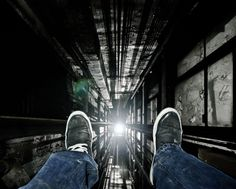 These vertigo-inducing images were taken by a real-life spider-man who scales derelict buildings in Detroit to take astonishing birds-eye shots. Daredevil Dennis Maitland, 24, climbs into lift shafts, up former office blocks and over the edge of balconies to snap his incredible photos, looking directly down.